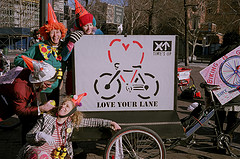 Love Your Lane sign bike on Grand Street Clown Ride photo by Peter Meitzler