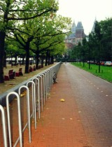 Many bike racks along a park in Amsterdam. Photo by Jym Dyer.