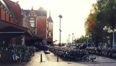 Bike parking at a train station in Amsterdam. Photo by Jym Dyer.