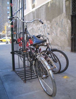 A window guard used to park bikes. Photo by Jym Dyer.