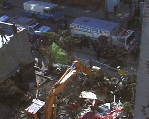A bulldozer destroys Esperanza Community Garden, 6th Street between Avenues B & C.